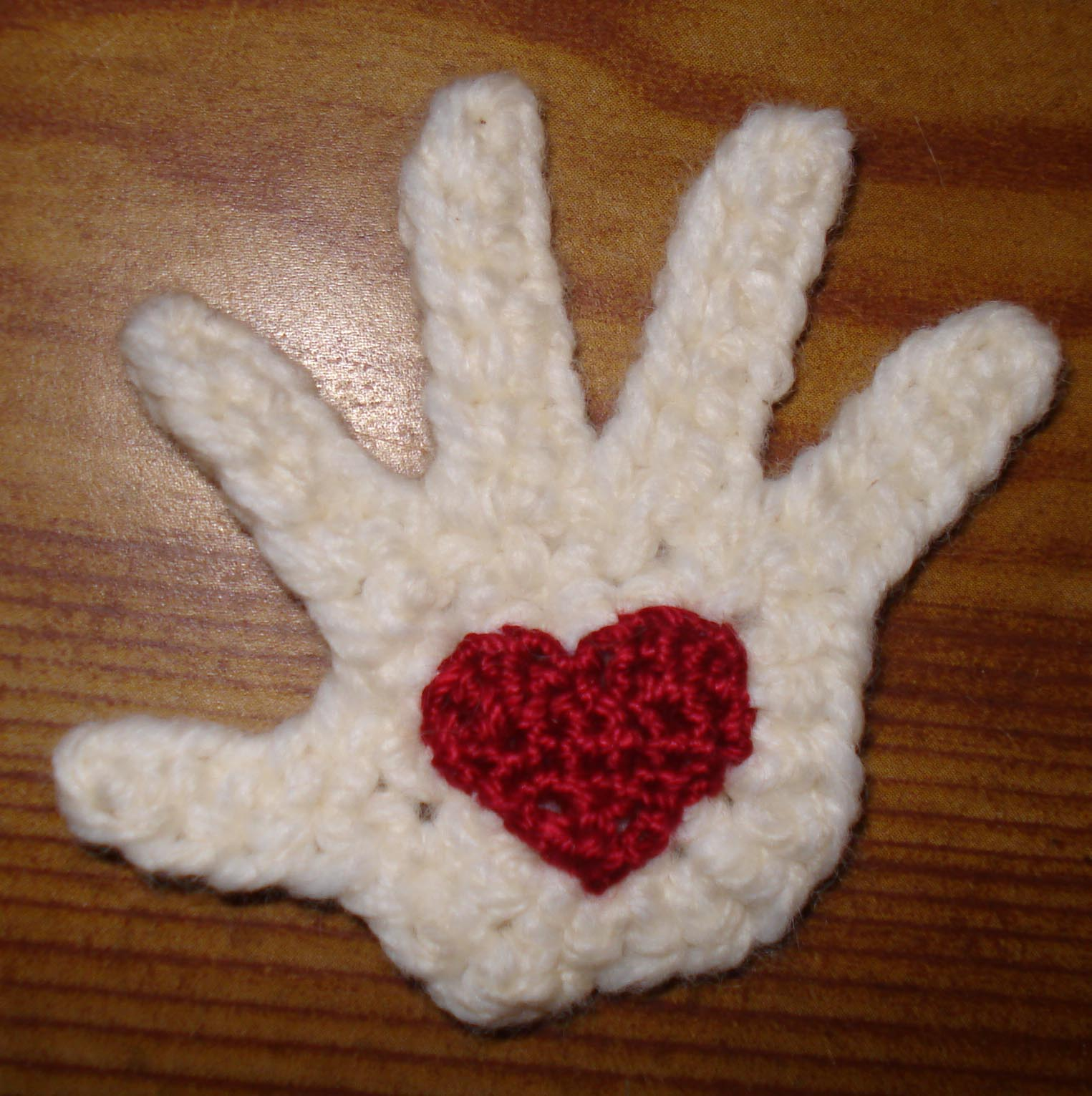 Crocheted hand with heart